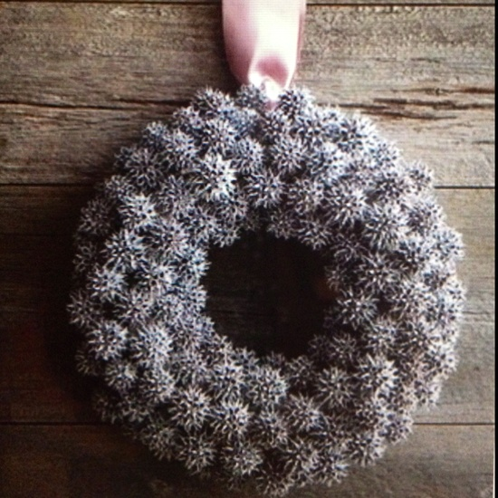 Holiday wreath lightly spray painted white makes it look frosty!