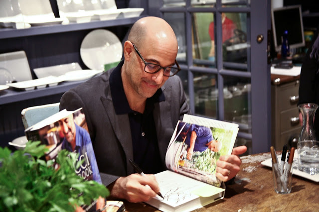 Stanley Tucci signing books at Fishs Eddy. Photo courtesy of the Fishes Eddy blog, Table of Content.