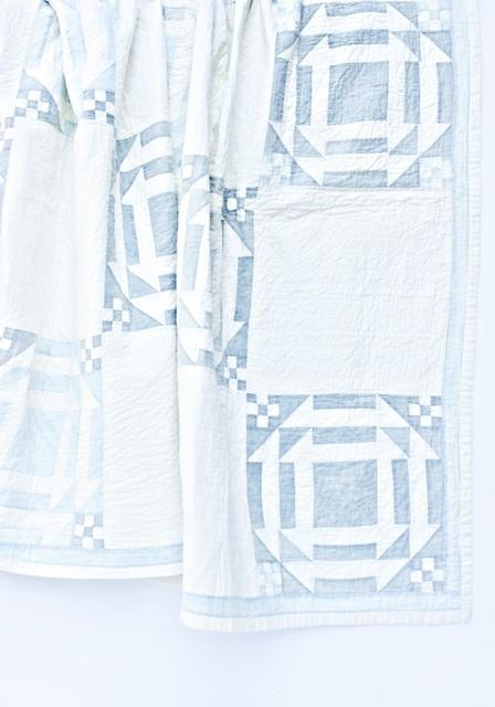 Martha's churn dash style quilt, which Ms. Jeannie now keeps.