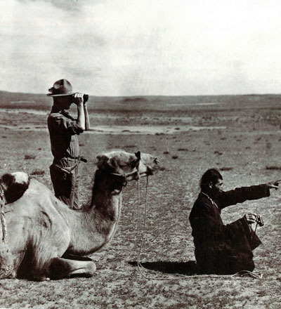 The accessories of an exotic explorer - a camel, binoculars ando courtesy of mongoliantravels.com a foreign guide! Phot