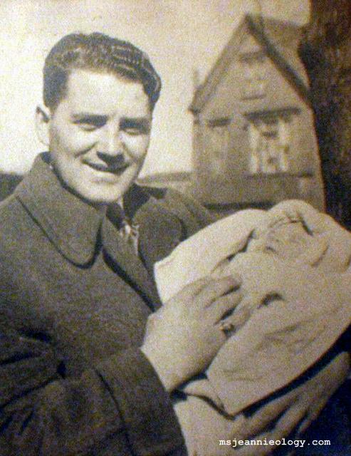 Grandpa Herbert holding Ms. Jeannie's dad.