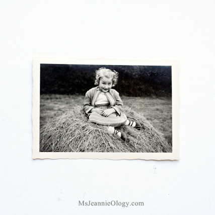 Little Carola on haystack circa 1957. $6.00 Love her shoes!