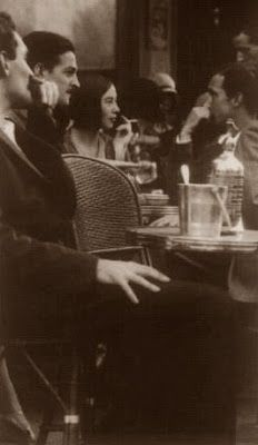 Ernest amid the 1920's Parisian cafe scene.